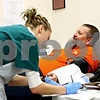 Rob Winner – rwinner@daily-chronicle.com<br /> Bri Famera, a phlebotomist, fills out paperwork as Russ Lovell, of Sycamore, relaxes and watches television while having platelets drawn at the Heartland Blood Centers location in DeKalb, Ill. on Thursday January 7, 2010.