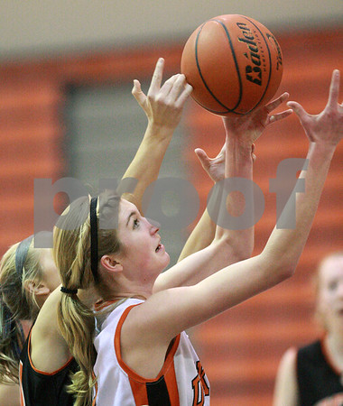 Kyle Bursaw – kbursaw@daily-chronicle.com<br /> <br /> DeKalb's Courtney Bemis goes for a rebound in the second quarter. The DeKalb girls fell to the Wheaton Warrenville South Tigers 33-37 at Naperville North High School in Naperville, Ill. on Thursday, Dec. 23, 2010.