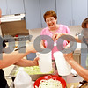 Beck Diefenbach  -  bdiefenbach@daily-chronicle.com<br /> <br /> Volunteers Matt Croull, left, Barbara Anderson, center, and VAC program director Nancy Hicks put together the free community dinner at the VAC lunch room in the Elder Care Center in DeKalb, Ill., on Wednesday July 7, 2010.