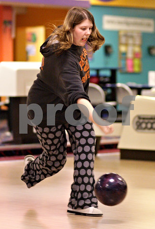 Beck Diefenbach  -  bdiefenbach@daily-chronicle.com<br /> <br /> DeKalb senior Courtney Cochrane releases her ball during bowling practice at Mardi Gras Lanes in DeKalb, Ill., on Tuesday Feb. 9, 2010.