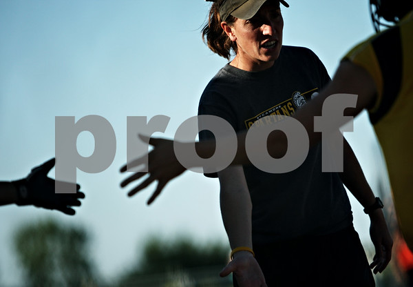 Beck Diefenbach  -  bdiefenbach@daily-chronicle.com<br /> <br /> Sycamore head coach Jill Carpenter  leads the celebration near the end of the IHSA Class 2A Regional semi final game against DeKalb at Sycamore High School in Sycamore, Ill., on May 27, 2010.