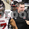 Kyle Bursaw – kbursaw@daily-chronicle.com<br /> <br /> Coach Tom Matukewicz leads the NIU players onto Ford Field for the MAC Championship game between against the Miami (Ohio) Redhawks in Detroit, Mich. on Friday, Dec. 3, 2010.