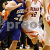 Beck Diefenbach  -  bdiefenbach@daily-chronicle.com<br /> <br /> Geneva's Michael Santacaterina (20, left) slams into DeKalb's Jordan Threloff (42), fouling him during the third quarter of the game at DeKalb High School, in DeKalb, Ill., on Friday Jan. 5, 2010. DeKalb defeated Geneva 55 to 52.