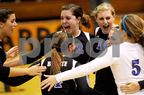 Beck Diefenbach  -  bdiefenbach@daily-chronicle.com<br /> <br /> Geneva's Ashley Boser (12, center) and Riley Sullivan (16, right) celebrate with their team after scoring a point during the first game of a match against DeKalb at DeKalb High School in DeKalb, Ill., on Thursday Sept. 9, 2010. Geneva defeated DeKalb 2 to 0.