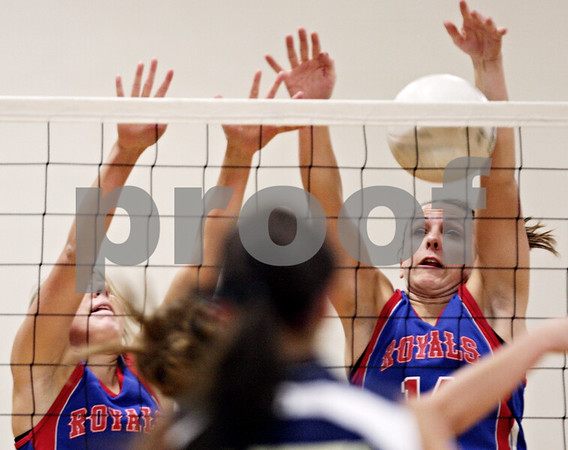 Beck Diefenbach – bdiefenbach@daily-chronicle.com<br /> <br /> Hinckley-Big Rock's Kaitlin Phillips (14, right) attempts to block a shot during the first game of a match against Hiawatha at Hiawatha High School in Kirkland, Ill., on Thursday  Sept. 16, 2010. H-BR defeated Hiawatha 2 to 0.