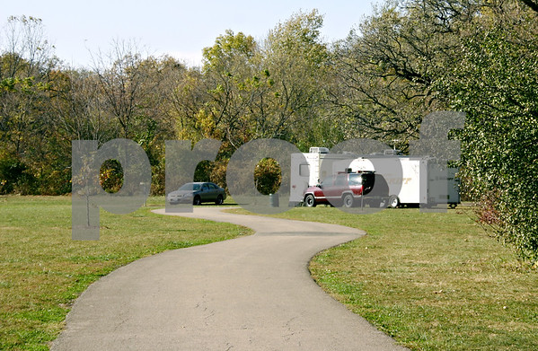 Kate Schott – kschott@daily-chronicle.com<br /> <br /> The mobile command center is set up in Prairie Park near the pedestrian bridge in DeKalb, Ill. The Prairie Park is one area investigators are searching as part of their investigation into missing NIU student Antinette Keller.