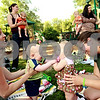 Beck Diefenbach  -  bdiefenbach@daily-chronicle.com<br /> <br /> (Far left) Sharon Ashley, of DeKalb, and her son Chase, 7 months, play with Tina Holtz, of Sycamore, (far right) and her daughter Fiona, 7 months, during a Crunchie Moms playdate at Sycamore Lake Rotary Park in Sycamore, Ill., on Thursday July 29, 2010.