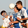 Beck Diefenbach – bdiefenbach@daily-chronicle.com<br /> <br /> (From left) Genoa-Kingston's Matt Define (12), Rockford Christian's Marko Ivancich (22) and Cody Mech (20) all leap to head the ball during the second half of the game at G-K High School in Genoa, Ill., on Thursday Sept. 30, 2010. G-K defeated Rockford Christian 1 to 0.
