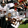 Rob Winner - rwinner@daily-chronicle.com<br /> <br /> DeKalb's Devonte Ragsdale goes to the outside for a big gain in the first quarter of their game in Ottawa, Ill. on Friday August 27, 2010.