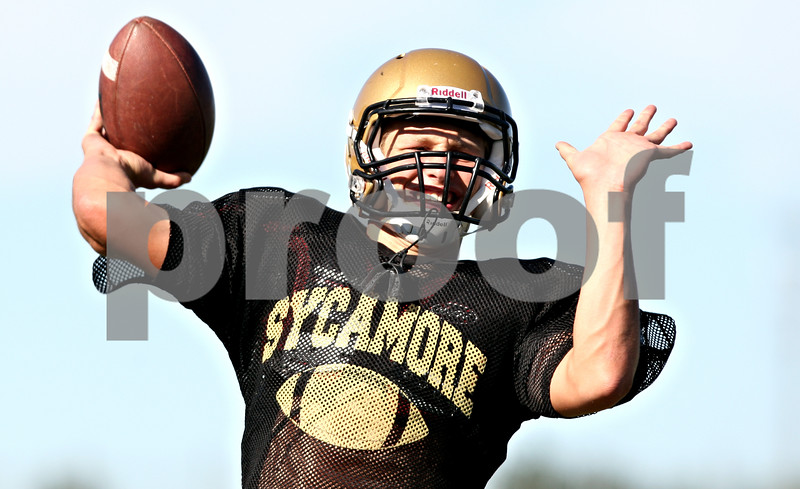 Rob Winner  -  rwinner@daily-chronicle.com<br /> <br /> Sycamore quarterback Ryan Bartels works on throwing during practice on Wednesday September 8, 2010.