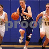 Beck Diefenbach  -  bdiefenbach@daily-chronicle.com<br /> <br /> Hinckley-Big Rock's Jenna Thorp (20) dribbles with the ball during the second quarter of the IHSA Class 1A Super Sectional championship game against Stockton at Judson University in Elgin, Ill., on Monday Feb. 22, 2010.