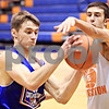 Beck Diefenbach  -  bdiefenbach@daily-chronicle.com<br /> <br /> Genoa-Kingston's Nick Lopez (22, left) and Bryan Buamgarten (5) during practice at G-K High School in Genoa, Ill., on Monday Jan. 4, 2010.