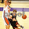 Beck Diefenbach - bdiefenbach@daily-chronicle.com<br /> <br /> DeKalb's Dylan Donnelly (12, right) dribbles around Oswego's Andrew Ziemnik (left) during the second quarter of the sectional championship game at Hampshire High School in Hampshire, Ill., on Friday March 12, 2010. Oswego defeated DeKalb 57 to 51, ending the Barb's season.