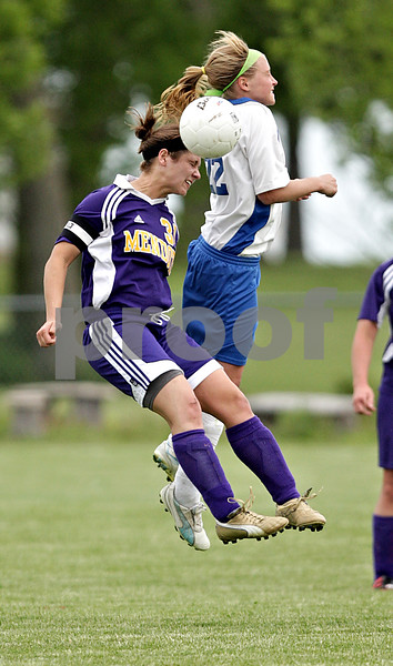Beck Diefenbach  -  bdiefenbach@daily-chronicle.com<br /> <br /> Hinckley-Big Rock's Maxzine Rossler (22, right) and Mendota's Lauren Becker  (31) during the first half of the game at H-BR in Hinckley, Ill., on Tuesday May 18, 2010.