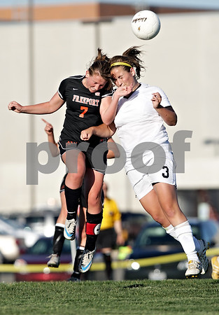 Beck Diefenbach  -  bdiefenbach@daily-chronicle.com<br /> <br /> Freeport's Caitlin Green (7, left) and Sycamore's Briana Henke (3, right) collide while jumping to head a ball during the second half of the IHSA Class 2A sectional final game at Hampshire High School in Hampshire, Ill., on Friday May 28, 2010.