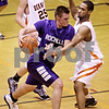 Beck Diefenbach  -  bdiefenbach@daily-chronicle.com<br /> <br /> Rochelle's Micah McCulloch (44, left) tries to dribble around Dekalb's Craig Lane (40) during the first quarter of the game at DeKalb High School  in DeKalb, Ill., on Friday Jan. 8, 2010.