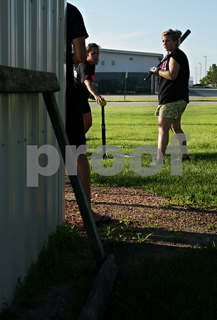 Beck Diefenbach  -  bdiefenbach@daily-chronicle.com<br /> <br /> Becca Schroeder, left, places the ball as teammate Caitlin Shearer, right, takes part in batting practice at Kishwuakee Community College in Malta, Ill., on Tuesday June 22, 2010.