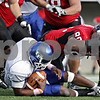 Rob Winner – rwinner@daily-chronicle.com<br /> <br /> Buffalo quarterback Jerry Davis is tackled for a loss by Northern Illinois defensive end Alan Baxter during the second quarter of their game in DeKalb, Ill. on Saturday October 16, 2010.