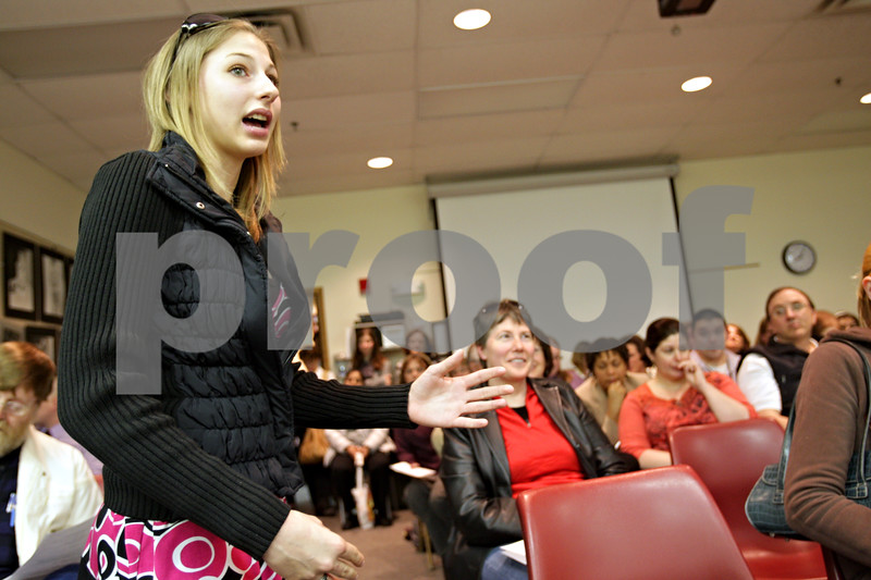 Beck Diefenbach  -  bdiefenbach@daily-chronicle.com<br /> <br /> DeKalb High School senior Courtney Nelson speaks in support of not increasing class size as part of budget reduction during the public comments portion of the DeKalb School District 428 board meeting at the Education Center in DeKalb, Ill., on Tuesday March 16, 2010.