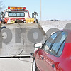 Rob Winner – rwinner@daily-chronicle.com<br /> <br /> John Sturgill of GreenCo Towing in Yorkville tows a vehicle that was stuck in a field off of Somonauk Road in Squaw Grove Township on Monday.
