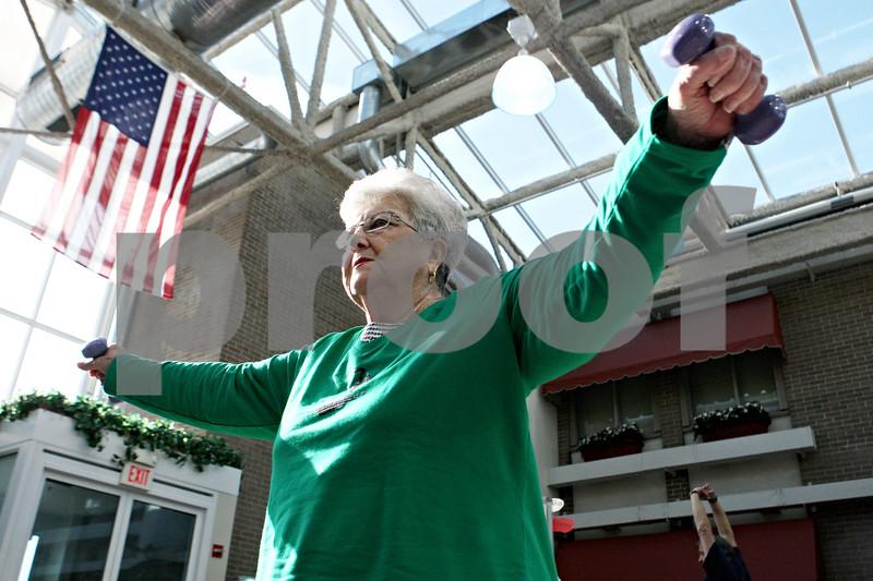 Rob Winner – rwinner@daily-chronicle.com<br /> As part of her cardiac rehabilitation program, Yvonne Anderson, of DeKalb, lifts weights on Thursday February 11, 2010 at Kishwaukee Community Hospital in DeKalb, Ill.