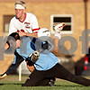 Rob Winner – rwinner@daily-chronicle.com<br /> <br /> Matt Kyler (top) and Byron goalkeeper Riley Egan collide during a scoring chance for Indian Creek late in the second half of the regional quarterfinal game in Waterman, Ill. on Wednesday October 13, 2010. Indian Creek went on to defeat Byron, 2-1, in double overtime.