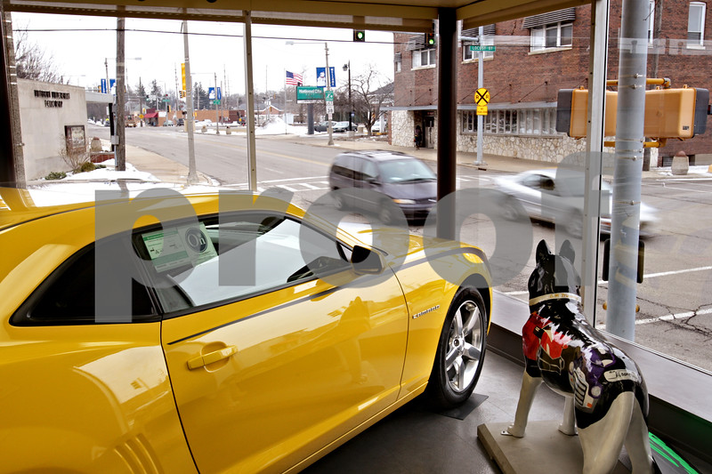 Beck Diefenbach  -  bdiefenbach@daily-chronicle.com<br /> <br /> A Chevrolet Camero looks out onto the intersection of the 4th Street and E. Locust Street at Mike Mooney Chevrolet-GMC-Cadillac in DeKalb, Ill., on Monday on Feb. 8, 2010.