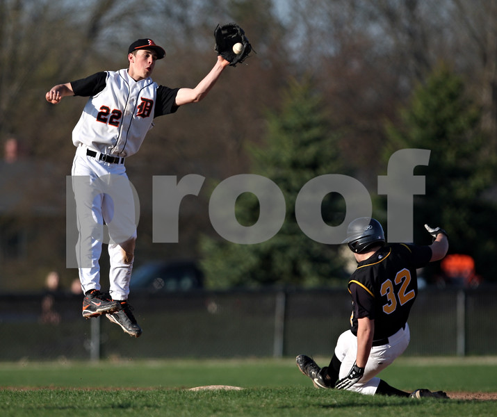 Beck Diefenbach  -  bdiefenbach@daily-chronicle.com<br /> <br /> DeKalb's Brian Sisler (22, left) catches the ball as Sycamore's Adam Dobson (32, right) slides safe into second base during the fourth inning of the game at DeKalb High School in DeKalb, Ill., on Friday April 9, 2010.