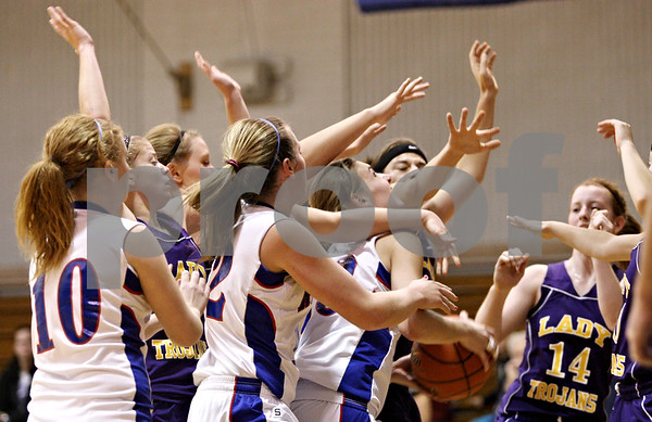Rob Winner – rwinner@daily-chronicle.com<br /> <br /> Hinckley-Big Rock's Tess Godhardt tries to take a shot in traffic during the second quarter in Hinckley on Tuesday night.