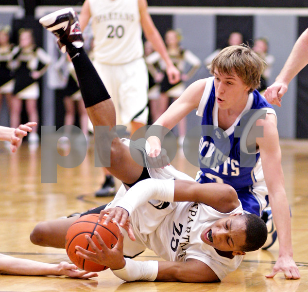 Beck Diefenbach  -  bdiefenbach@daily-chronicle.com<br /> <br /> Sycamore's Sam Ford (25, bottom) grabs the ball after he is fouled by Burlington Central's Steve Hall (10) during the second quarter of the IHSA Class 3A regional quarterfinal game at Kaneland High School in Maple Park, Ill., on Monday March 1, 2010.