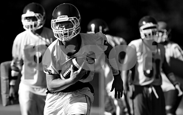 Rob Winner – rwinner@daily-chronicle.com<br /> <br /> Craig Billington carries the ball during the Cogs' morning practice on Thursday August 12, 2010 in Genoa, Ill.