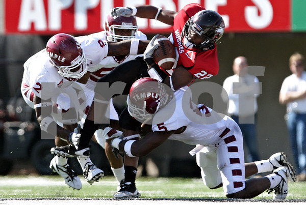 Rob Winner - rwinner@daily-chronicle.com<br /> <br /> Northern's Ricky Crider is tackled by a trio of Temple defenders during the second quarter of their game in DeKalb, Ill. on Saturday October 9, 2010. The Huskies went on to defeat Temple, 31-17.
