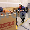 Kyle Bursaw – kbursaw@daily-chronicle.com<br /> <br /> Carvain Humphrey moves a large box of donations around the back at Goodwill in DeKalb, Ill. on Wednesday, Dec. 15, 2010.