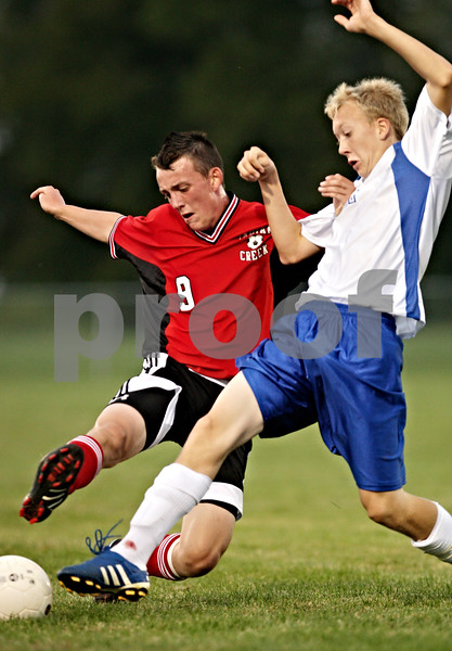 Beck Diefenbach – bdiefenbach@daily-chronicle.com<br /> <br /> Hinckley's Jacob Madden (11, right) and Indian Creek's Dillon Martenson (9) battle for the ball during the first half of the game at Hinckley-Big rock High School in Hinckley, Ill., on Monday Sept. 20, 2010.