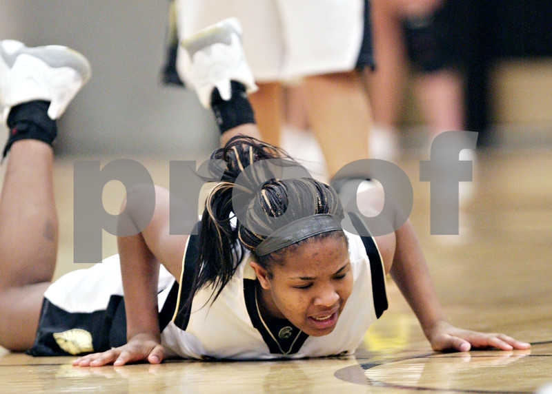 Beck Diefenbach  -  bdiefenbach@daily-chronicle.com<br /> <br /> Sycamore's Montia Johnson hits the ground after fighting for the ball during the first quarter of the game against Glenbard South at Sycamore High School in Sycamore, Ill., on Tuesday Feb. 2, 2010.