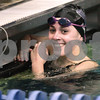 Kyle Bursaw – kbursaw@daily-chronicle.com<br /> <br /> Lauren Zima of St. Charles North is all smiles after seeing her time for the 100 butterfly. Zima took first place in the event with a time of 57.90 seconds at St. Charles North High School on Nov. 13, 2010.