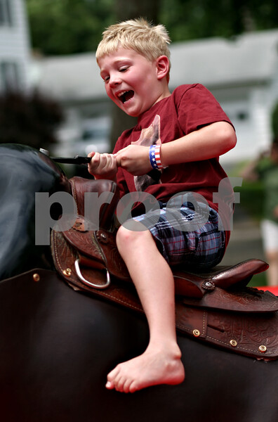 Beck Diefenbach  -  bdiefenbach@daily-chronicle.com<br /> <br /> William Engel, 6, of Hinckley, nearly falls off the mechanical bull during Fourth of July festivities in Shabbona, Ill., on Sunday.