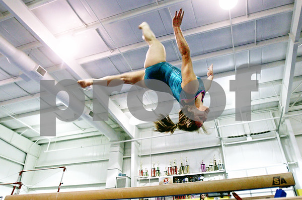 Rob Winner  -  rwinner@daily-chronicle.com<br /> <br /> Alyssa Lopez practices on the balance beam at Energym in Sycamore, Ill. on Friday June 25, 2010.