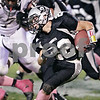 Rob Winner – rwinner@daily-chronicle.com<br /> <br /> Kaneland's Quinn Buschbacher carries the ball during the first quarter of their game in Maple Park, Ill. on Friday October 15, 2010.