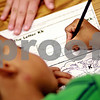 "Beck Diefenbach  -  bdiefenbach@daily-chronicle.com<br /> <br /> Jahmir Mojica, 5, practices writing the  letter ""K"" during a reading and writing tutoring session at the Northern Illinois University Literacy Clinic in DeKalb, Ill., on Wednesday July 14, 2010."