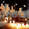 Beck Diefenbach  -  bdiefenbach@daily-chronicle.com<br /> <br /> The five crosses representing the victims of the shootings are adorned with candles from the vigil at the Martin Luther King Commons on the campus of NIU in DeKalb, Ill., on Sunday Feb. 14, 2010.