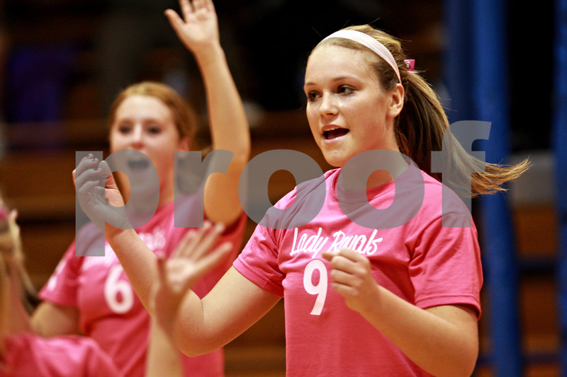 Beck Diefenbach – bdiefenbach@daily-chronicle.com<br /> <br /> Hinckley-Big Rock's Katie Hollis celebrates with her teammates after scoring a point during the first game against Somonauk in the Little 10 Conference Volleyball Tournament at H-BR High School in Hinckley, Ill., on Tuesday Oct. 5, 2010.