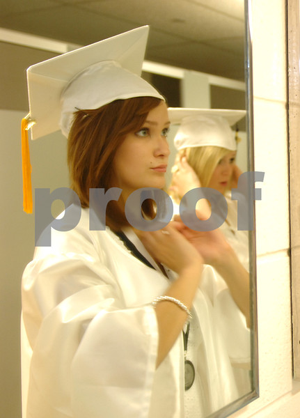 Kaneland graduates Megan Cline, left, and Haven Peavy fix their hair in the mirror before their commencement ceremony on Sunday, May 30, 2010 in Maple Park, Ill. (Marcelle Bright/for the Chronicle)