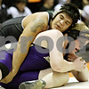 Rob Winner – rwinner@daily-chronicle.com<br /> <br /> Kaneland's Jim Boyle (top) holds Hononegah's Kelly Mason during their 285-pound quarterfinal match at the Don Flavin Tournament at DeKalb on Wednesday, Dec. 29, 2010.<br /> <br /> **Boyle of Kane won
