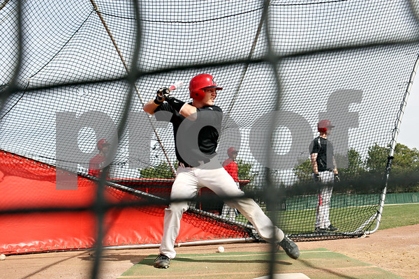 Rob Winner – rwinner@daily-chronicle.com<br /> <br /> Jordin Hood takes works on his swing during NIU baseball practice on Thursday April 1, 2010 in DeKalb, Ill.