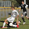 Rob Winner – rwinner@daily-chronicle.com<br /> <br /> Kaneland's Chad Swieca (front) and Sycamore's Joshua Gulke battle for a ball during the first half of their IHSA Class 2A Sycamore Regional semifinal on Wednesday October 20, 2010 in Sycamore, Ill. Kaneland went on to defeat Sycamore, 2-1.