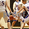 Beck Diefenbach – bdiefenbach@daily-chronicle.com<br /> <br /> Amboy Courtney Olson (23) is sandwiched by Hinckley-Big Rock's Kaitlin Phillips (back) and Tess Godhardt (right) during the first quarter of the IHSA Class 1A Regional Final game at Indian Creek High School in Shabbona, Ill., on Thursday Feb 11, 2010.
