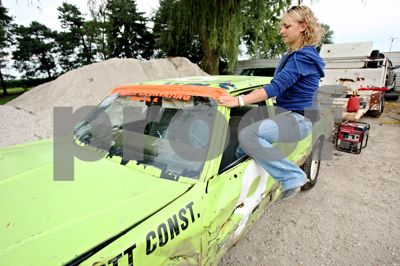 Rob Winner – rwinner@daily-chronicle.com<br /> <br /> Powder puff race car driver Danielle Heath, of Rolling Meadows, climbs into her 1986 Chevrolet Caprice at Sycamore Speedway in Maple Park, Ill. on Friday July 30, 2010.