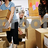Beck Diefenbach  -  bdiefenbach@daily-chronicle.com<br /> <br /> Kishwuakee College bookstore staffer Sheila Barnett and her coworkers unload a new shipment of paper in the back room of the college's bookstore in Malta, Ill., on Tuesday July 13, 2010.