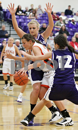 Beck Diefenbach  -  bdiefenbach@daily-chronicle.com<br /> <br /> DeKalb's Kelli Gerace (21, center) is defended by Rochelle's Shanna Metzger(25, top) and Natalie Meiners (12, right) during the second quarter of the IHSA Class 3A Regional game at Rochelle Township High School in Rochelle, Ill., on Wednesday Feb. 17, 2010
